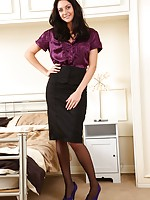 Long legged stunner dresses in tight pencil skirt and sexy satin blouse.